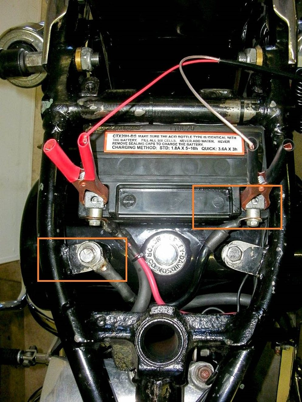 How To Remove And Install A Motorcycle Battery Revzilla Harlery Instruction Cycle Electric Wiring Diagram Look At The Ends Of Negative Cable All This Serves Do Is Connect Side Bikes Frame Allowing Entire