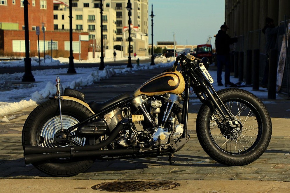 08a14adc614 A custom motorcycle with a sissy bar.